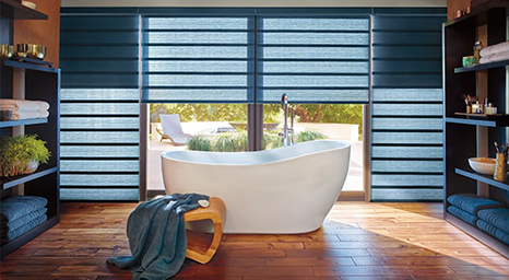 Hunter Douglas shades brings beauty and warmth to any space. Stop by our showroom to experience the full line of Hunter Douglas shades